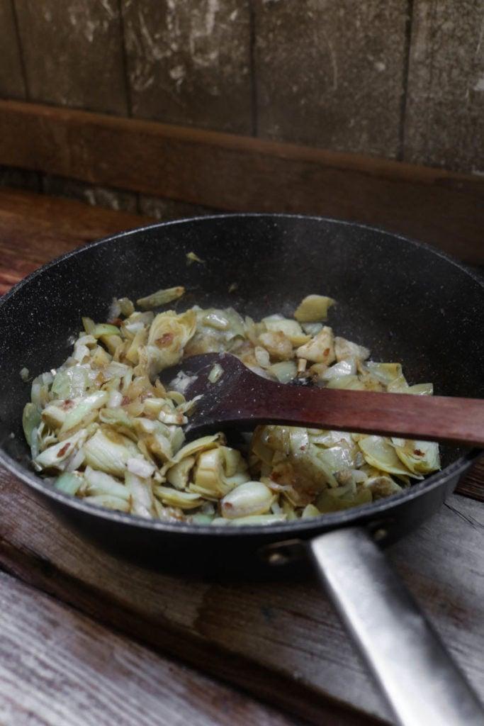 keto chicken spinach artichoke dip - saute onions